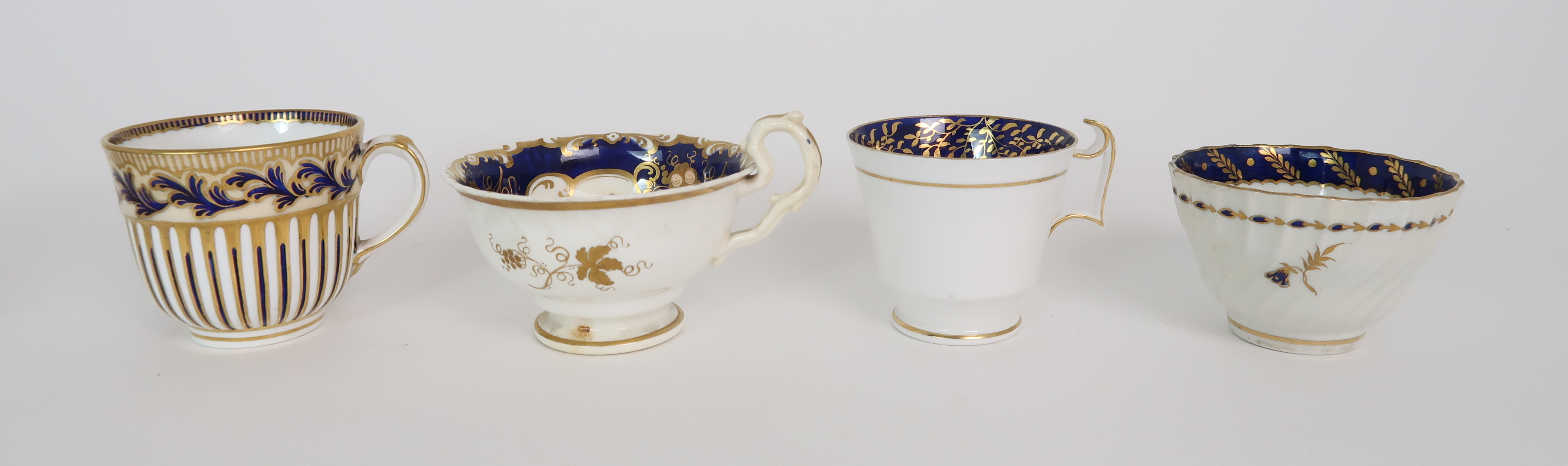 A COLLECTION OF 19TH CENTURY ENGLISH BLUE AND GILT DECORATED TEA AND COFFEE WARES including a - Image 11 of 23