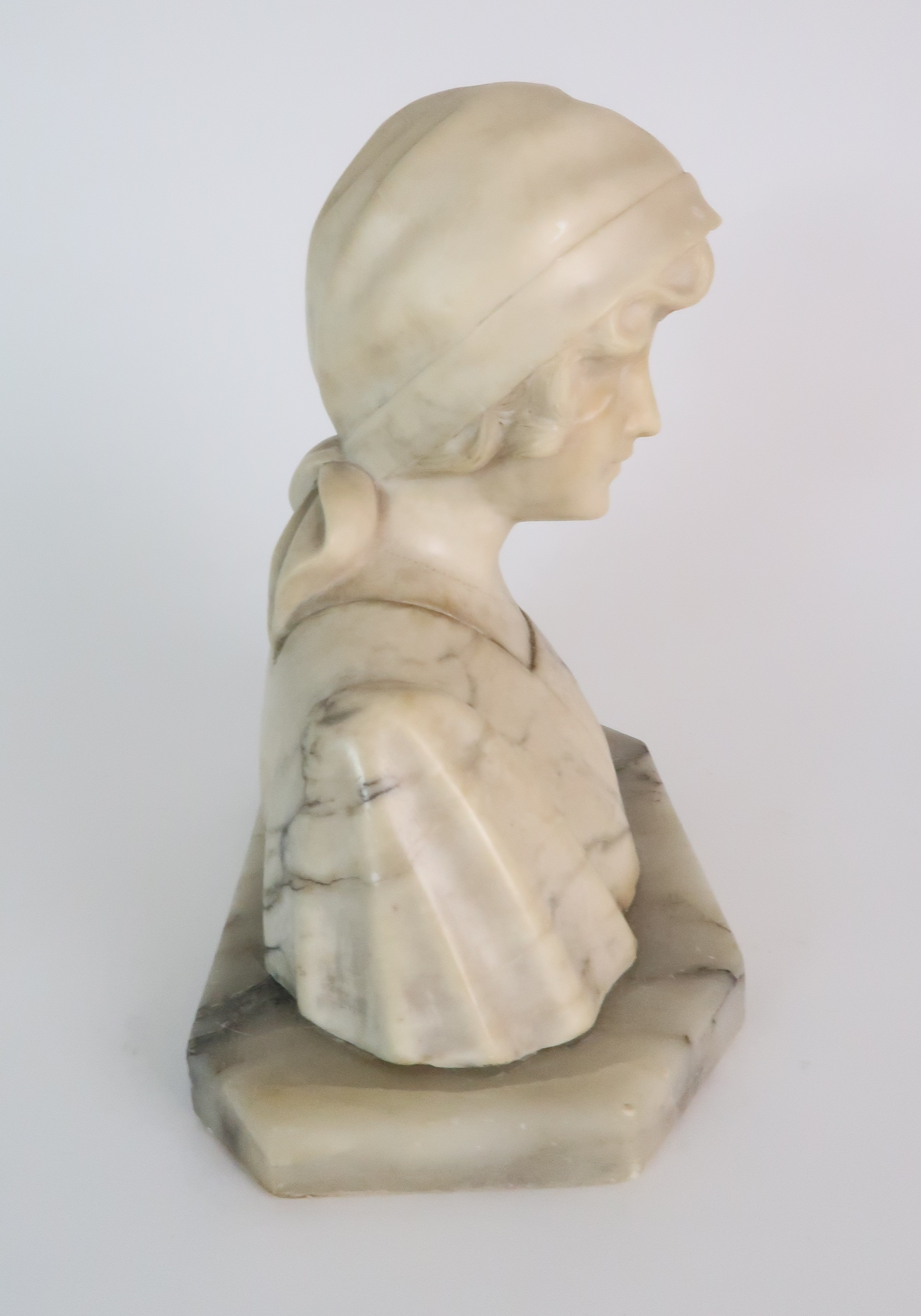 AN ALABASTER BUST OF A GIRL IN A HEAD SCARF upon shaped base, 25cm high Condition Report: - Image 4 of 5