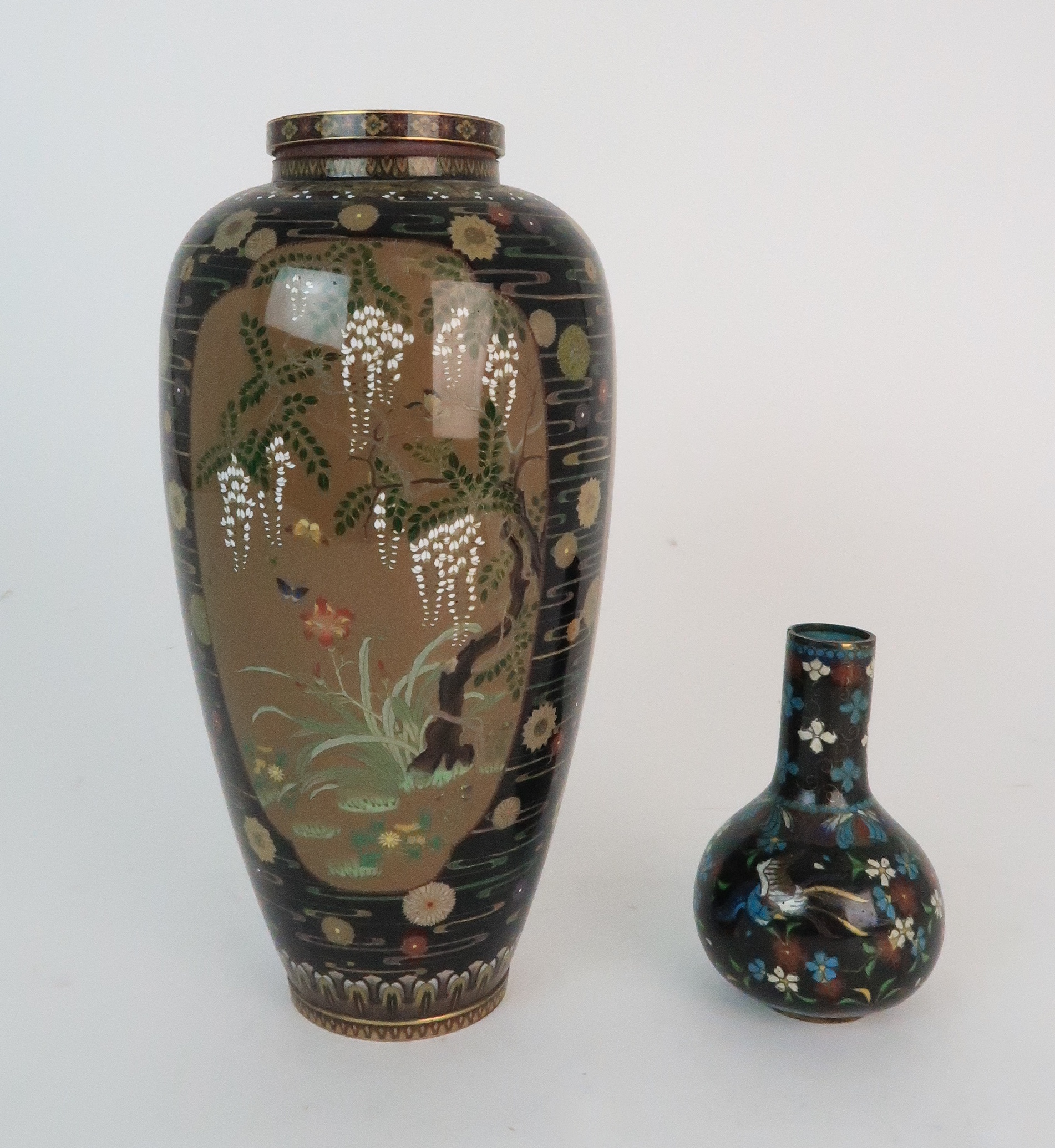 A JAPANESE CLOISONNE BALUSTER VASE finely decorated with panels of birds, butterflies, plants and