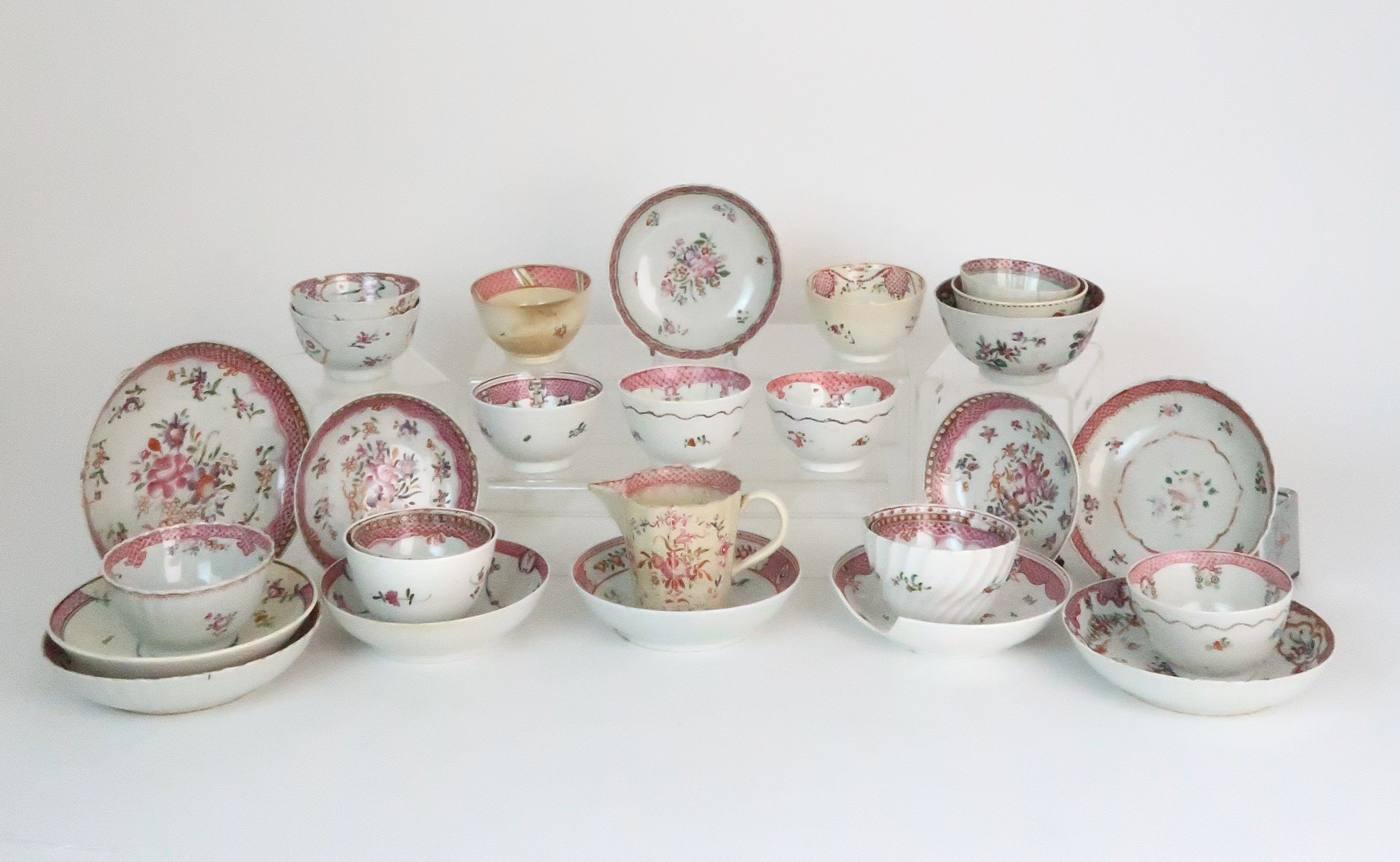 A COLLECTION OF TEA BOWLS AND SAUCERS each with pink scale and floral decoration including New Hall;