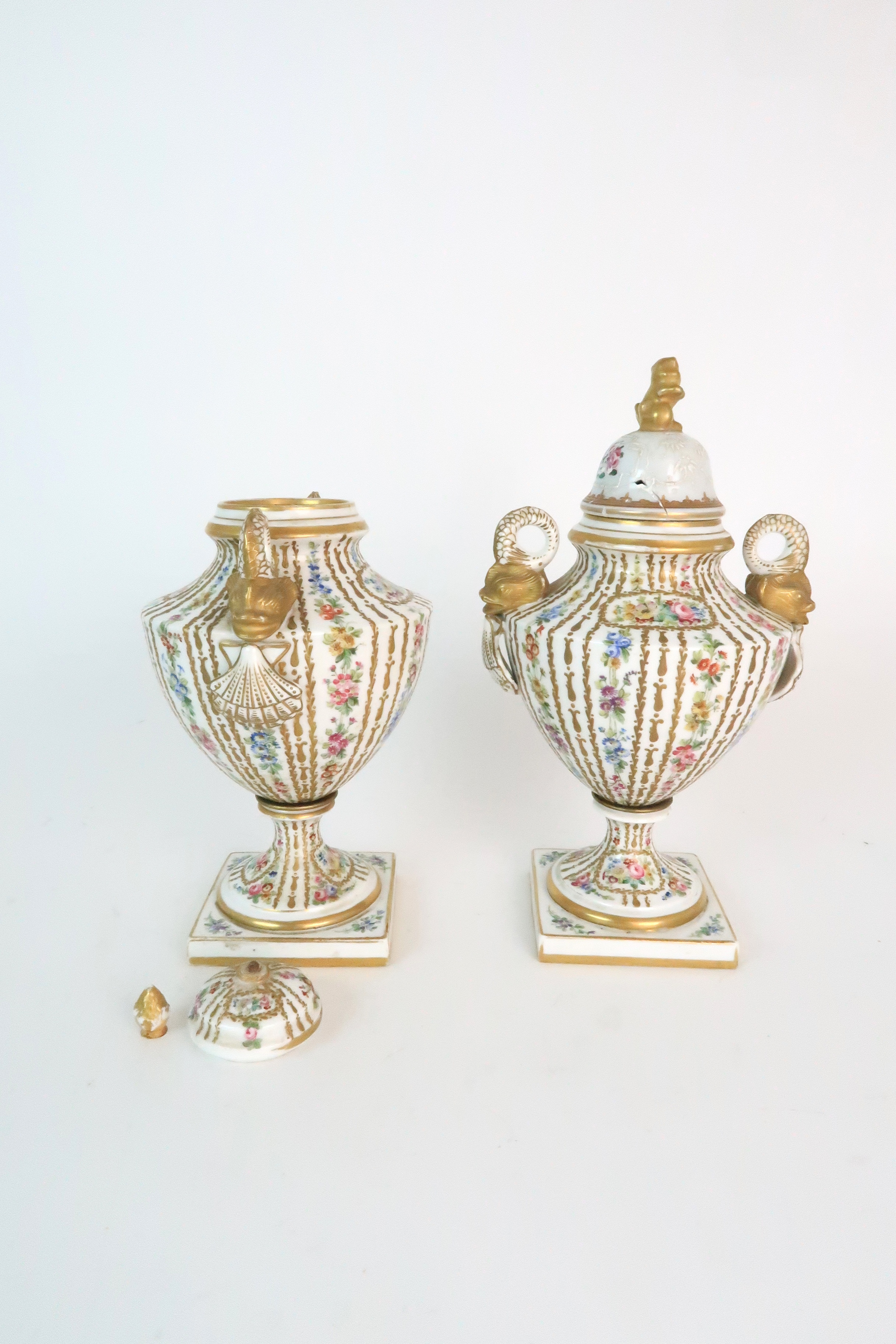 A PAIR OF CONTINENTAL PORCELAIN URNS each decorated with strings of flowers and gilt dot and dash - Image 3 of 16