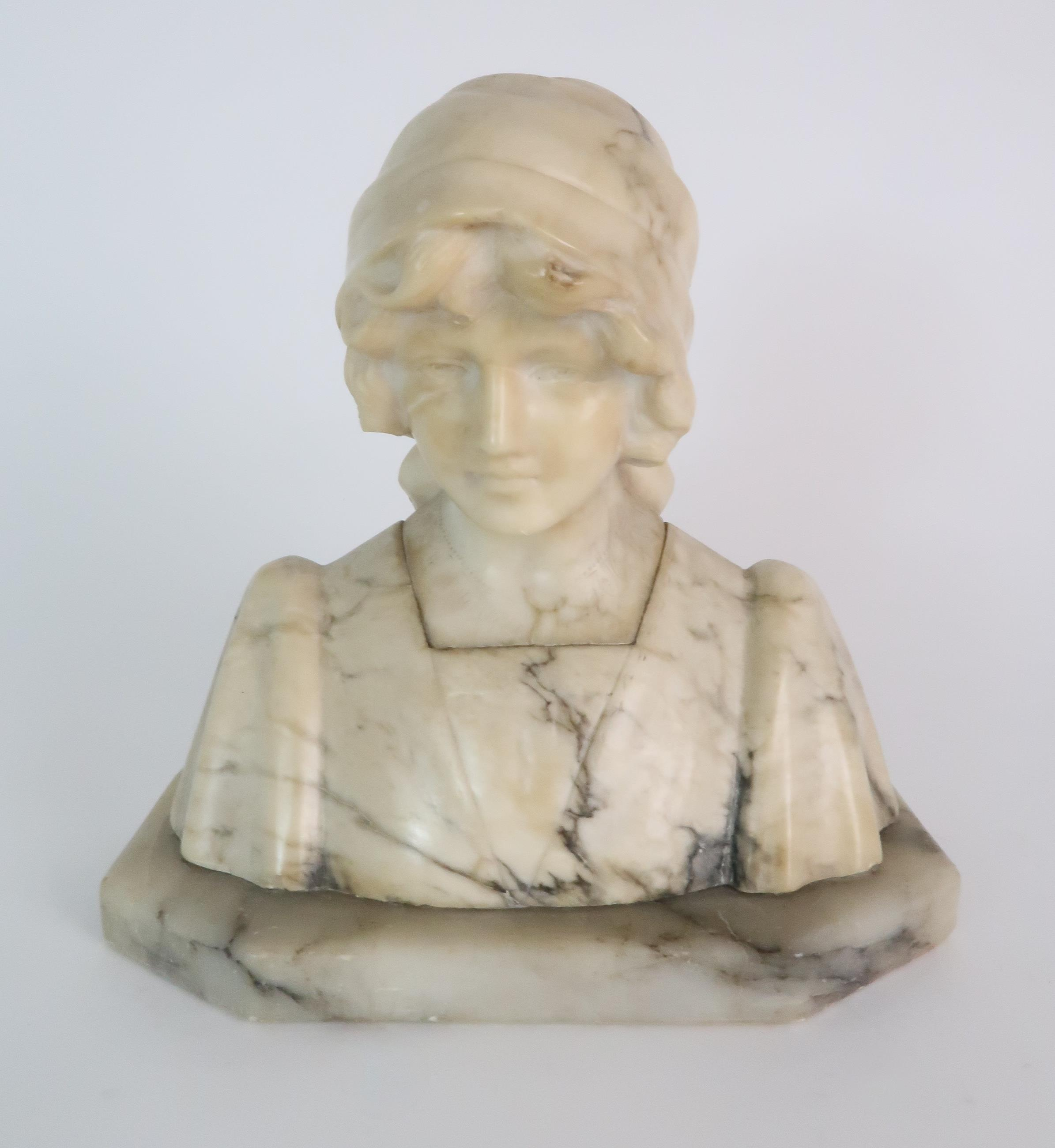 AN ALABASTER BUST OF A GIRL IN A HEAD SCARF upon shaped base, 25cm high Condition Report: