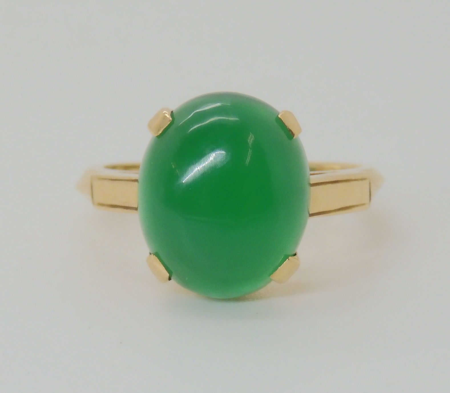 A 14K GREEN HARDSTONE SET RING Finger size M, weight 3.6gms Condition Report: Available upon