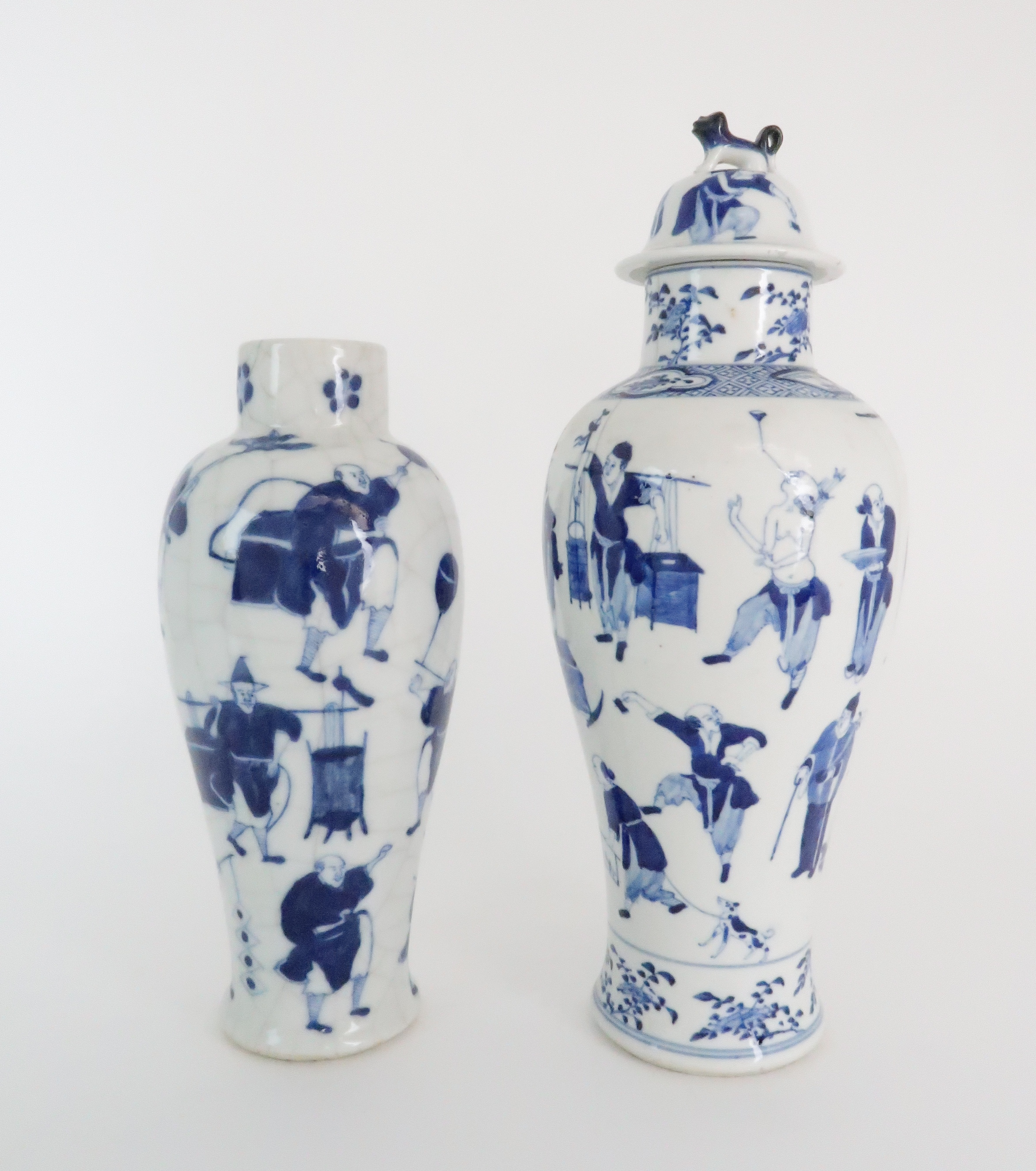 A CHINESE BLUE AND WHITE BALUSTER VASE AND COVER painted with numerous figures within foliate