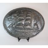 AN OVAL BEATEN PEWTER WALL PLAQUE OF THE DUNCAN RITCHIE 52 x 70cm Condition Report: Available upon