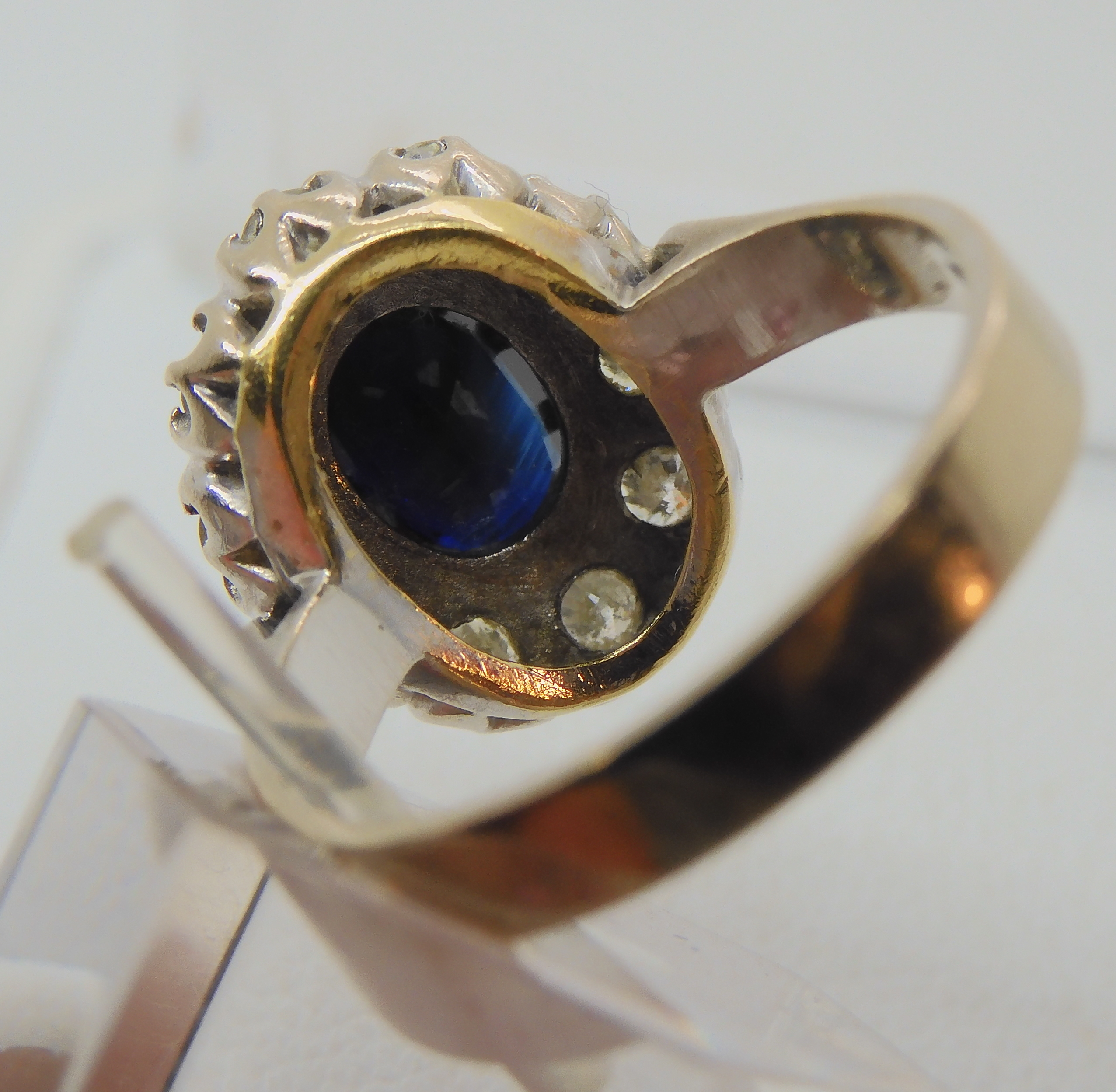 AN 18CT WHITE GOLD SAPPHIRE AND DIAMOND CLUSTER RING set with estimated approx 0.50cts of - Image 6 of 8