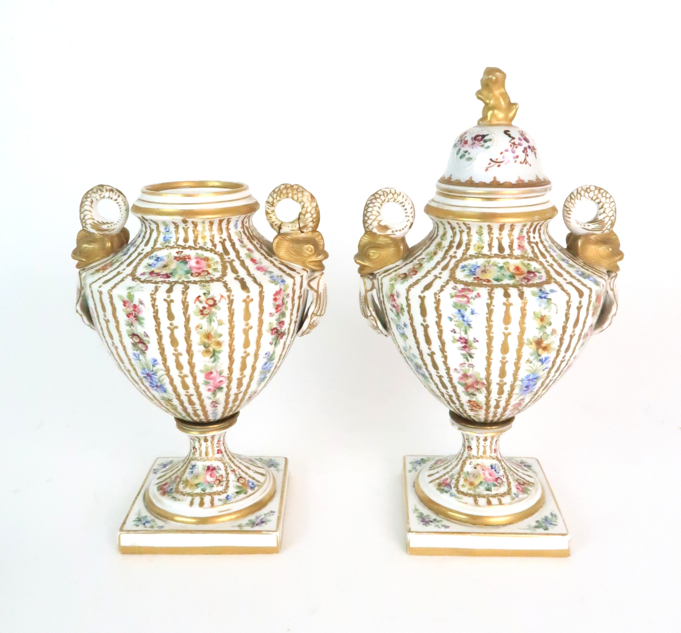A PAIR OF CONTINENTAL PORCELAIN URNS each decorated with strings of flowers and gilt dot and dash - Image 4 of 16