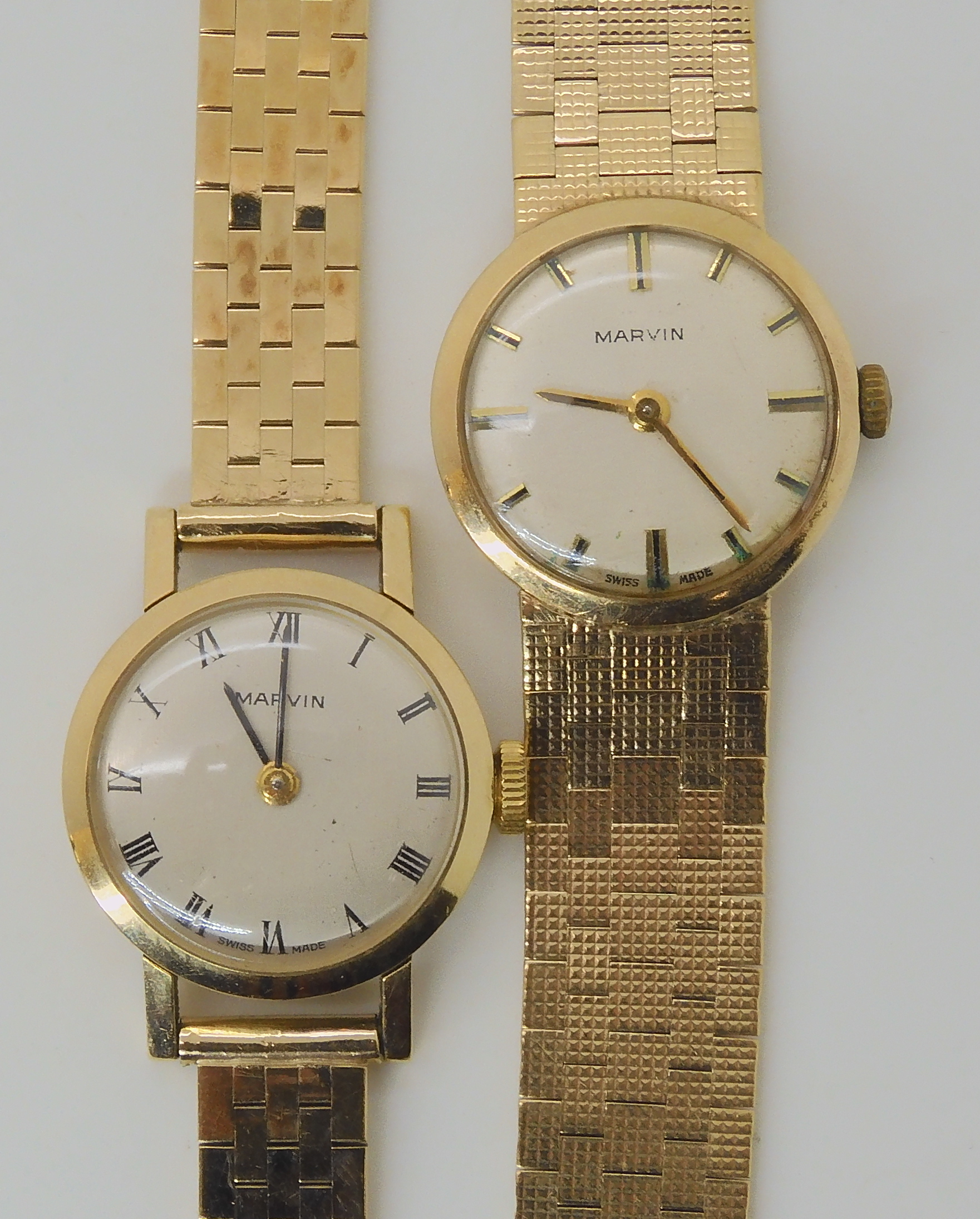 TWO 9CT GOLD LADIES MARVIN WATCHES the first with silvered dial black Roman numerals and baton