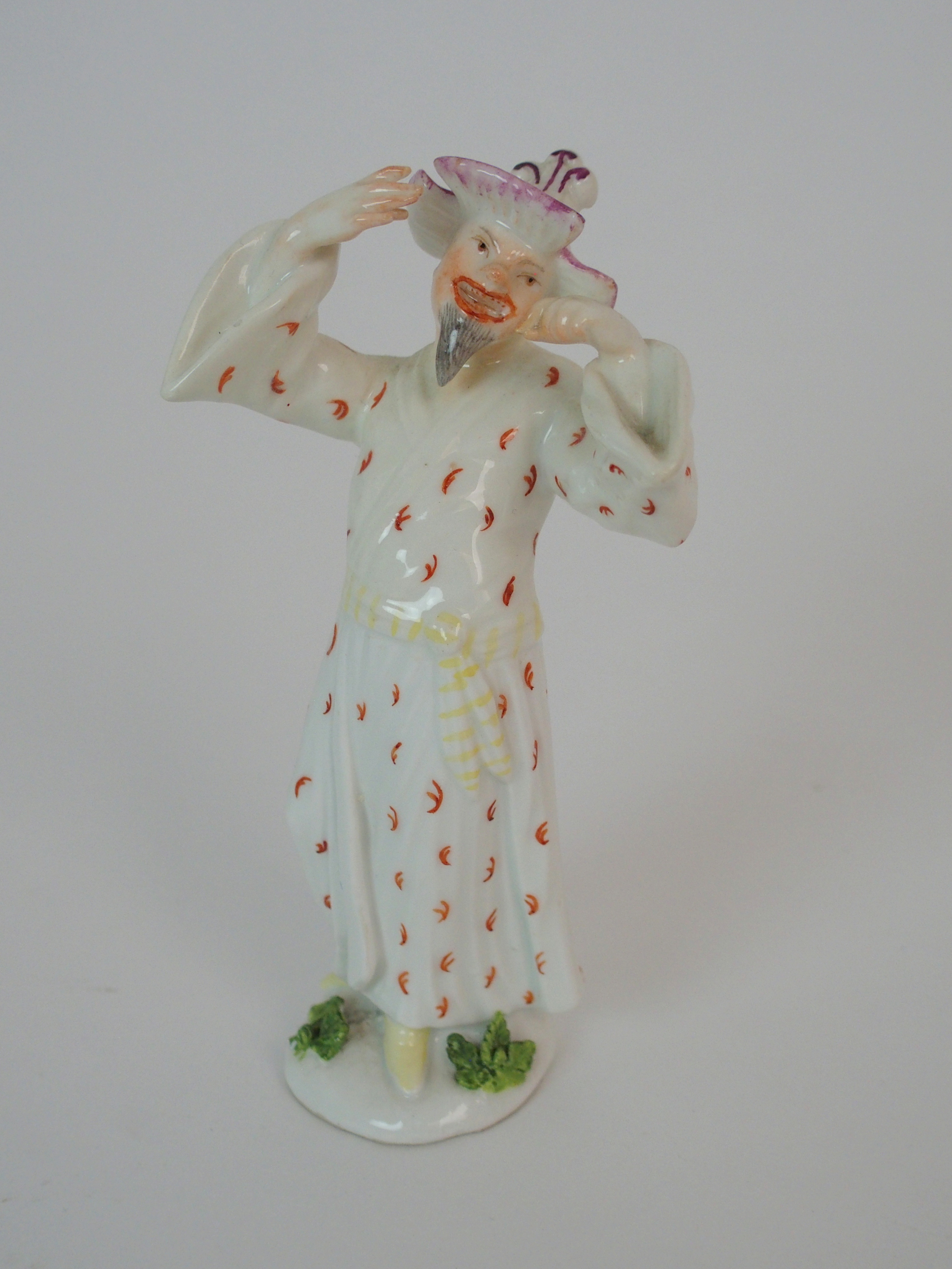 A MEISSEN FIGURE OF A CHINESE MAN 12cm high Condition Report: