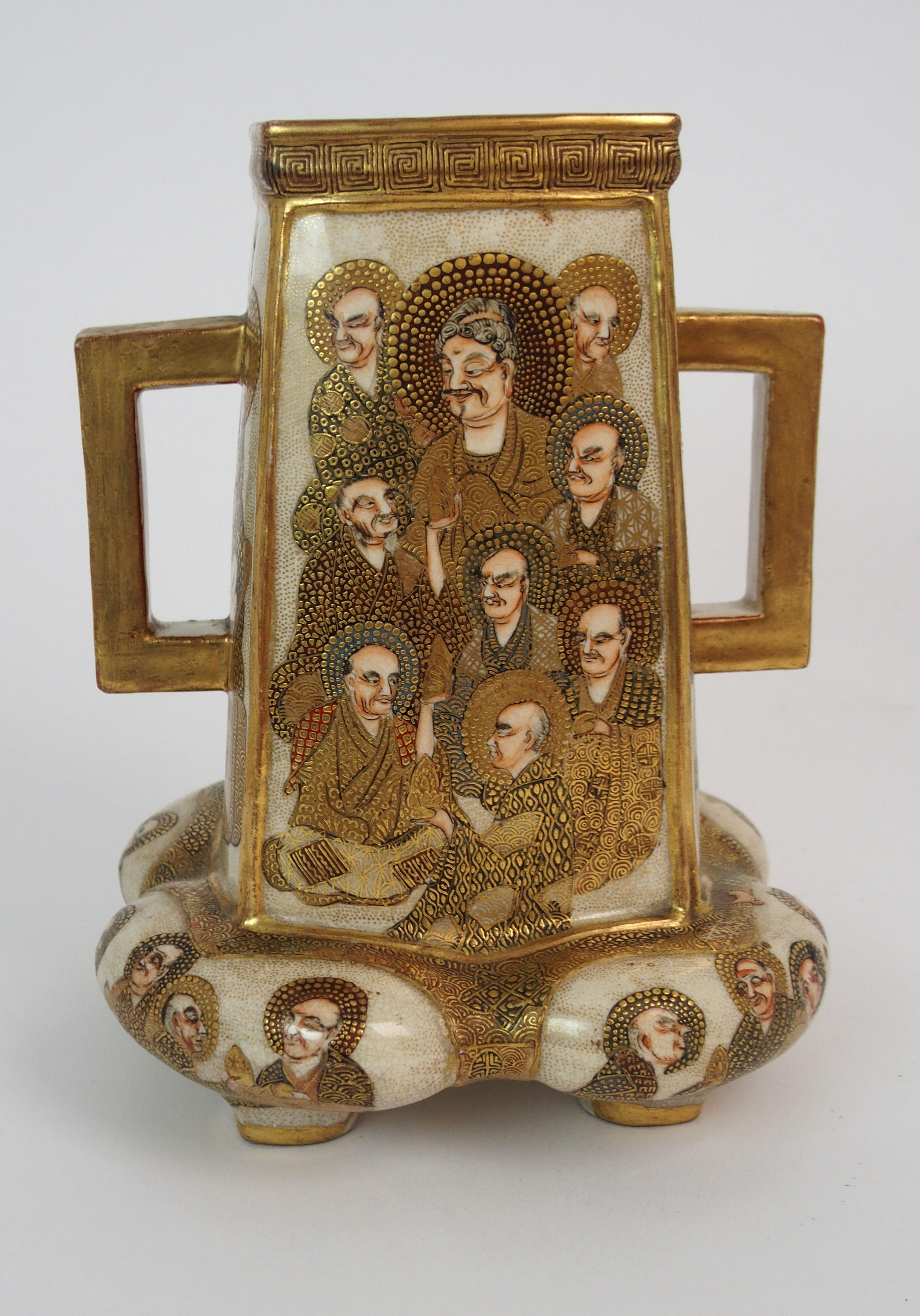 A SATSUMA SQUARE TAPERING TWO HANDLED VASE painted with mythical gods on a gilt ground, beneath