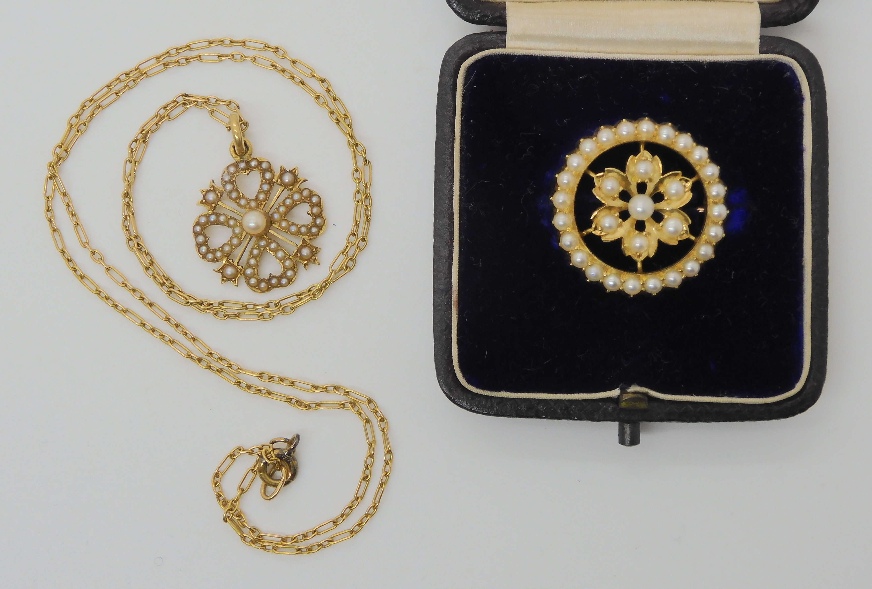 TWO VINTAGE PEARL SET ITEMS a brooch from the Goldsmiths & Silversmiths Co, in original fitted
