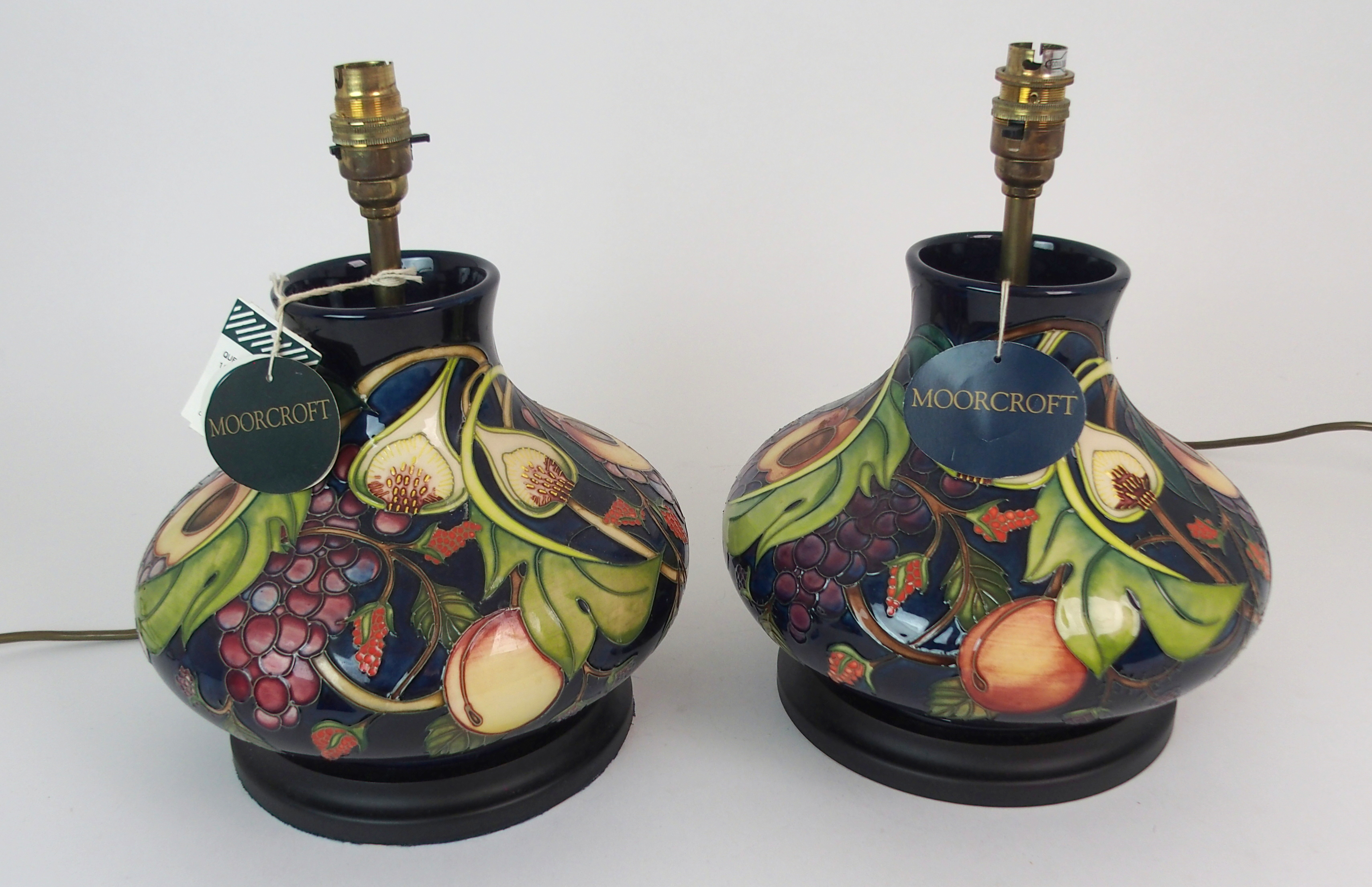 A PAIR OF MOORCROFT QUEENS CHOICE TABLE LAMPS of squat bulbous form, 31cm high Condition Report: - Image 2 of 5