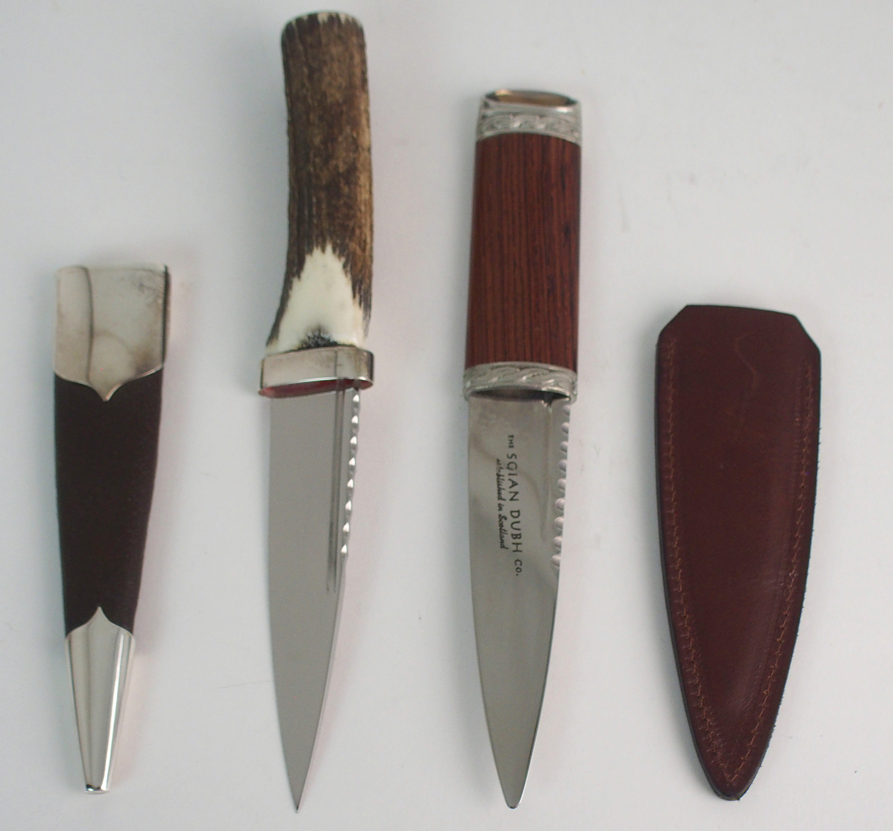 A SILVER-MOUNTED SGIAN DUBH BY HAMILTON & INCHES with brown goatskin scabbard and stag antler handle