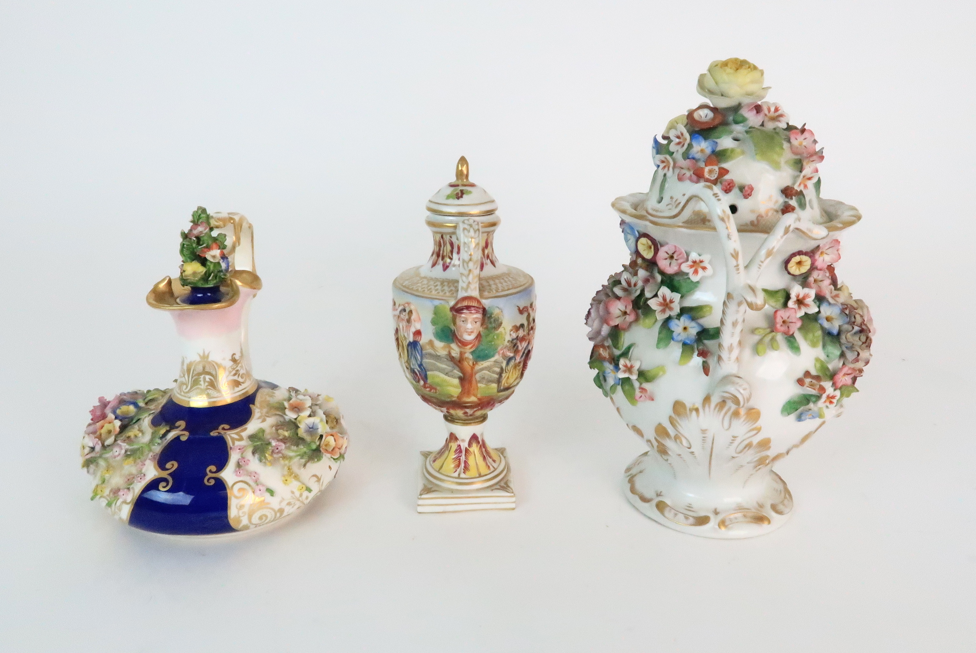 A PAIR OF CONTINENTAL PORCELAIN URNS each decorated with strings of flowers and gilt dot and dash - Image 8 of 16