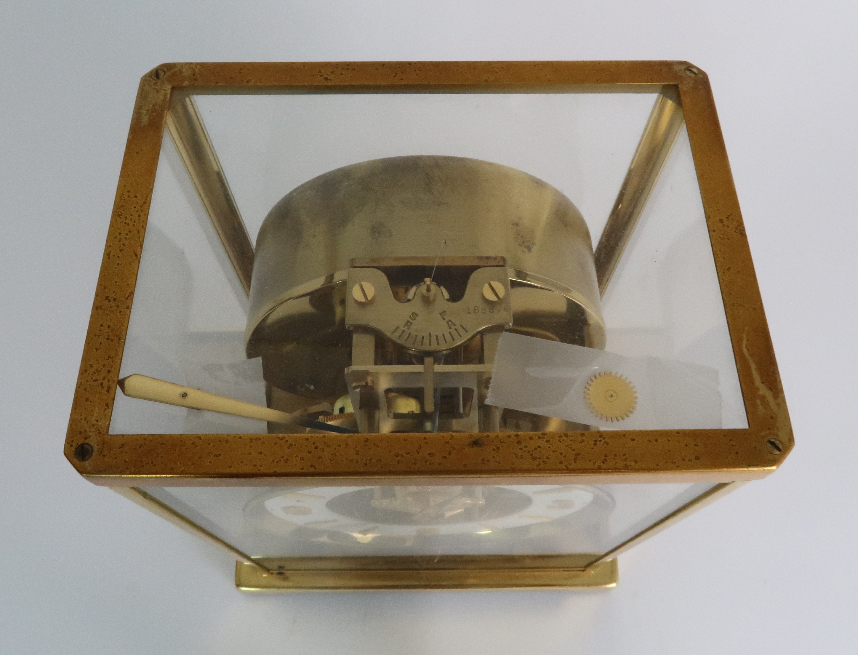 A JAEGER LE COULTRE ATMOS CLOCK in glazed brass case, the white enamel chapter ring with applied - Image 6 of 8