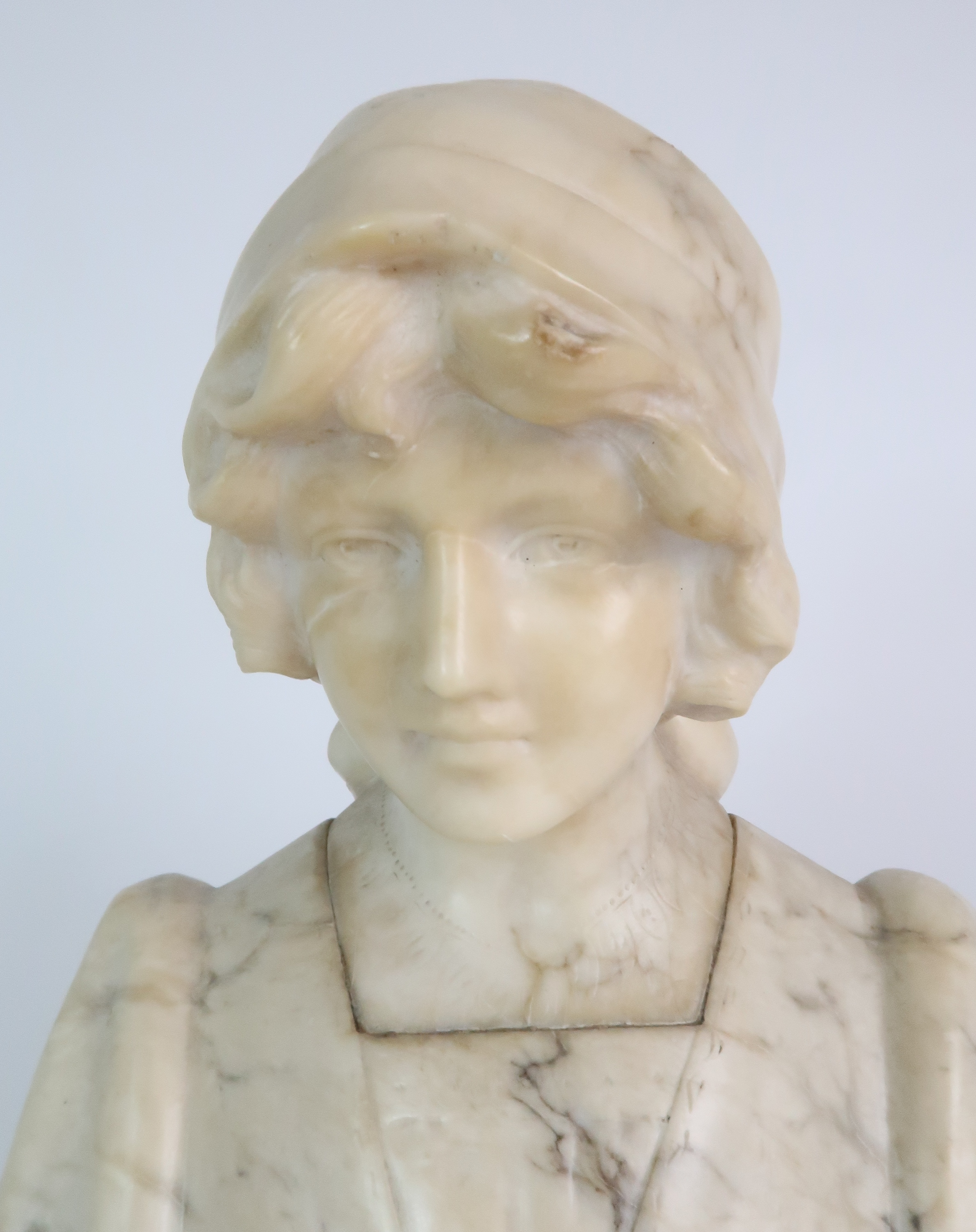 AN ALABASTER BUST OF A GIRL IN A HEAD SCARF upon shaped base, 25cm high Condition Report: - Image 5 of 5