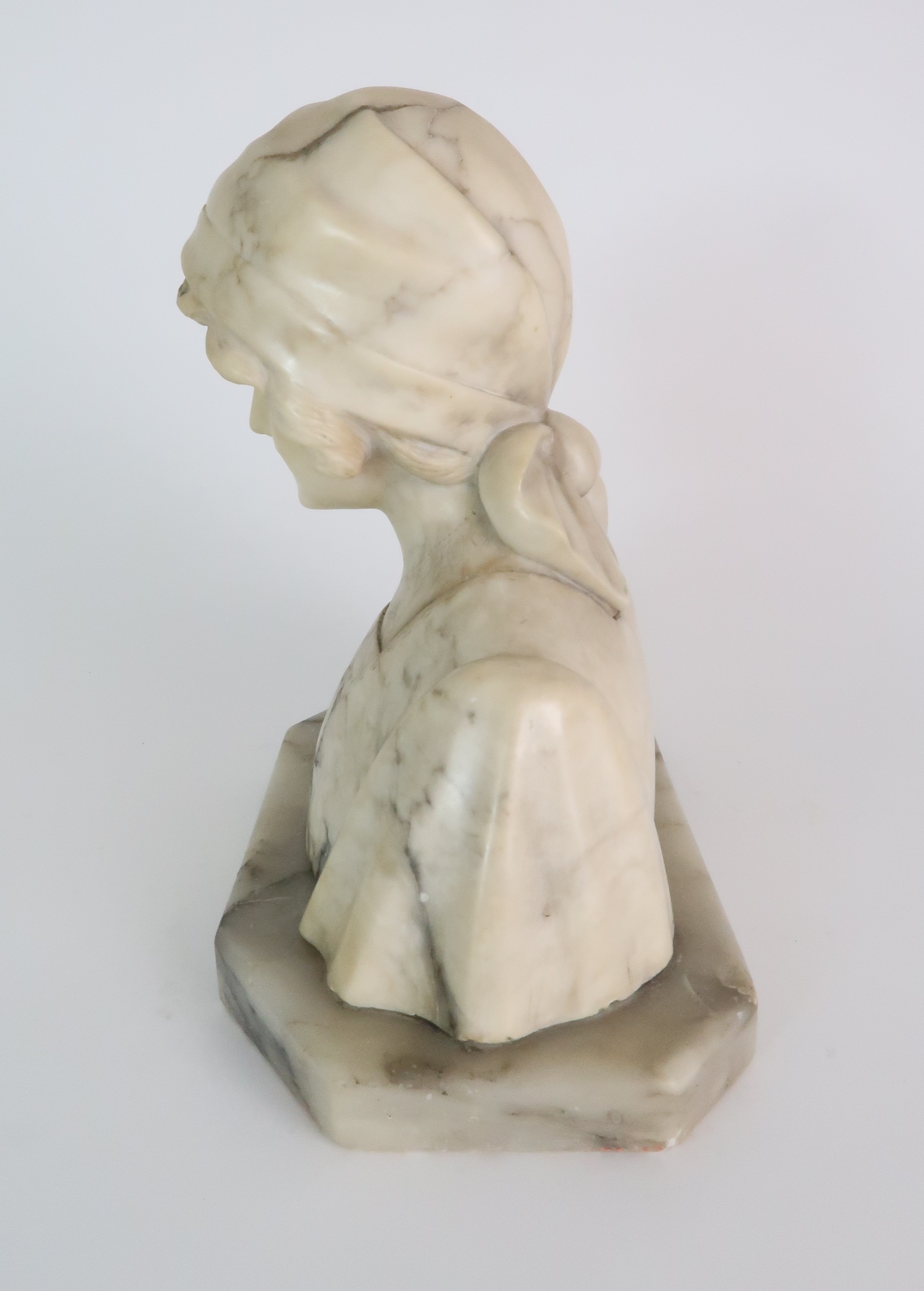 AN ALABASTER BUST OF A GIRL IN A HEAD SCARF upon shaped base, 25cm high Condition Report: - Image 2 of 5