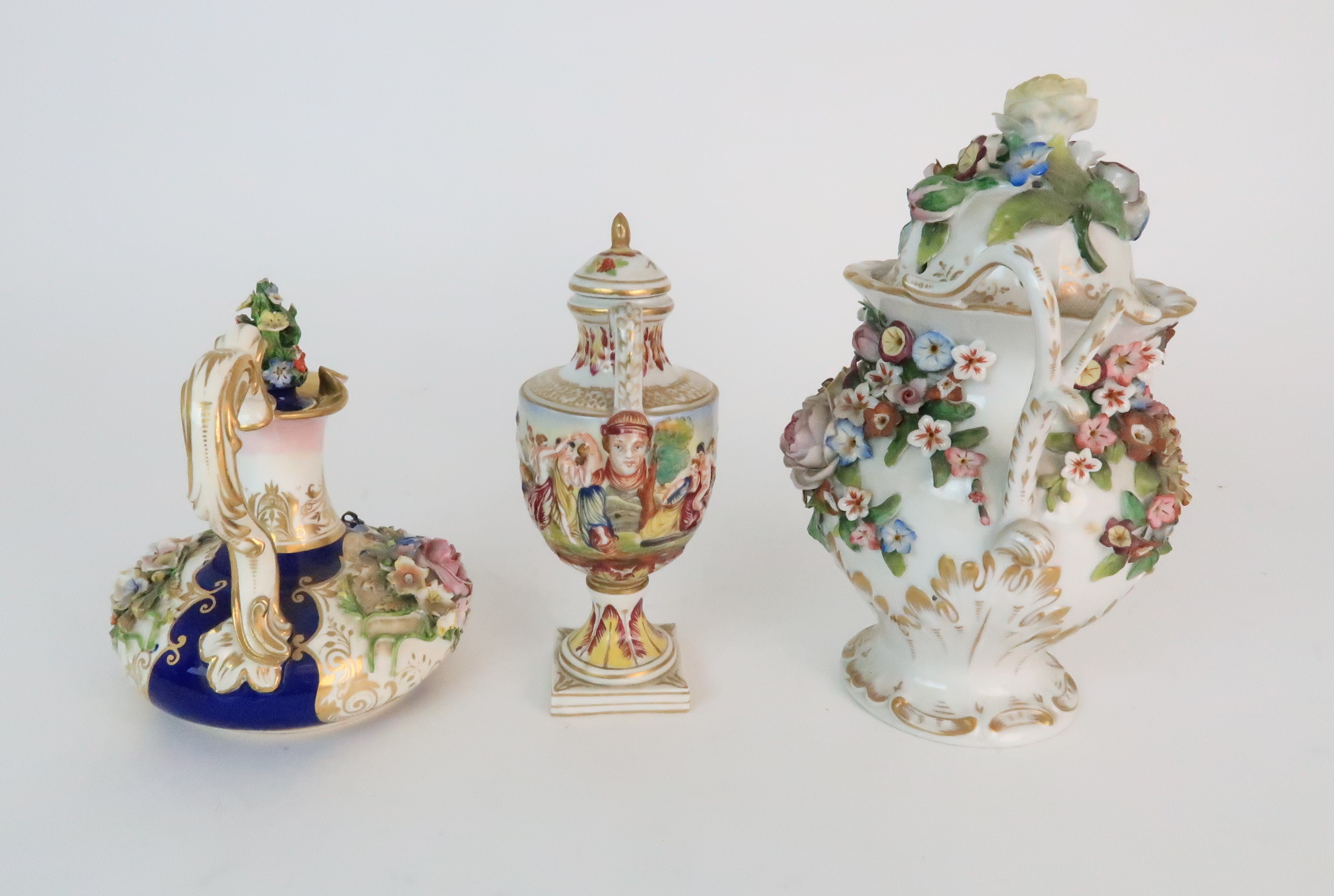 A PAIR OF CONTINENTAL PORCELAIN URNS each decorated with strings of flowers and gilt dot and dash - Image 10 of 16