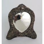 A HEART SHAPED BEVELLED MIRROR in silver mounted frame, maker's mark NC London 1906 32 cm x 27 cm
