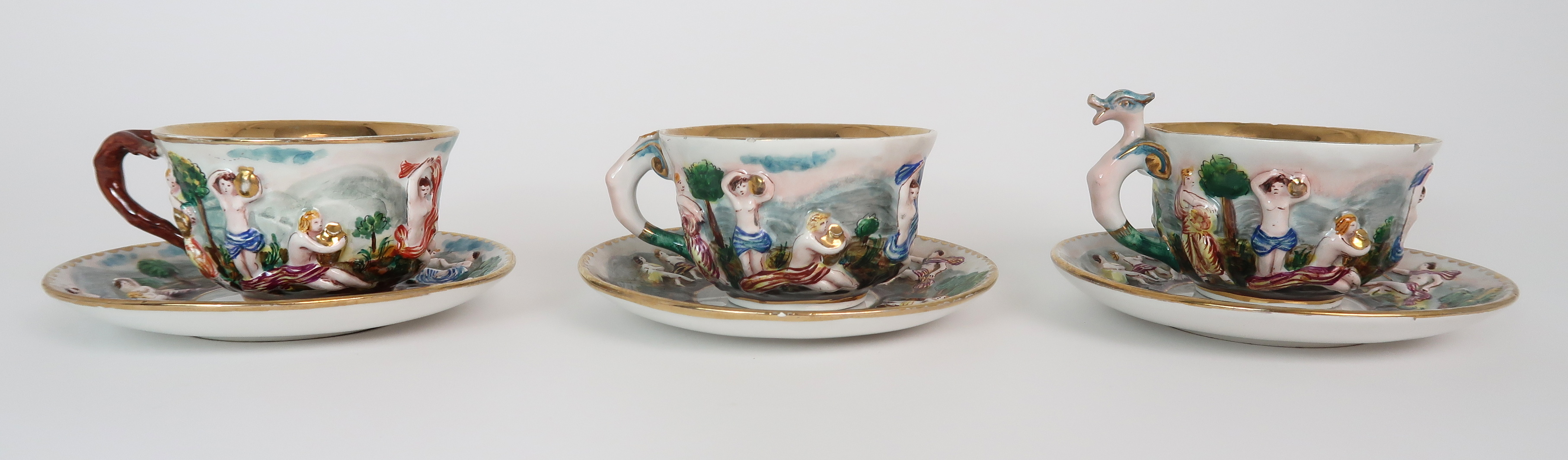 THREE CAPODIMONTE CUPS AND SAUCERS decorated with bacchanalian scenes, a pair of Sevres pots - Image 3 of 16