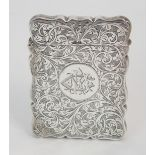A SILVER CARD CASE by Robert Chandler, Birmingham 1920, of rectangular shape with engraved foliate