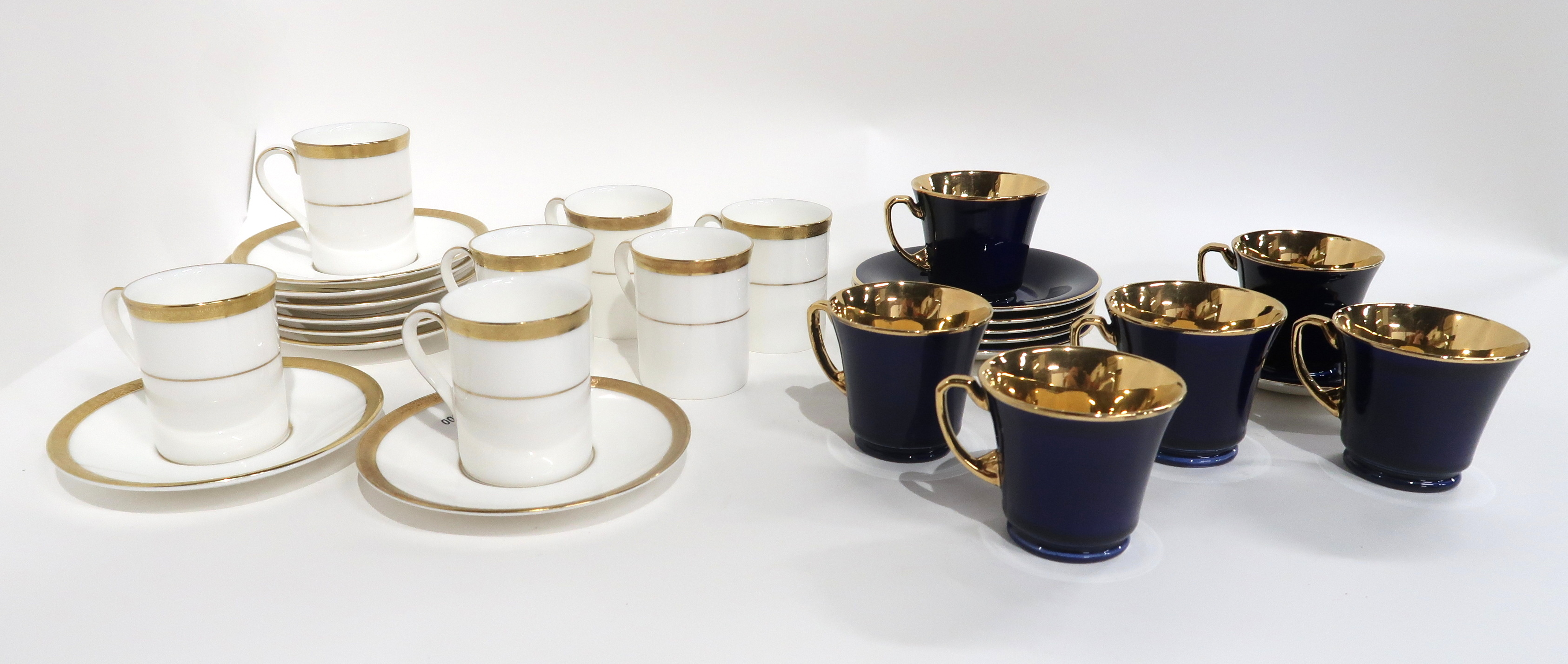 SIX CROWN DEVON DARK BLUE AND GILT COFFEE CUPS AND SAUCERS together with seven Royal Doulton Royal
