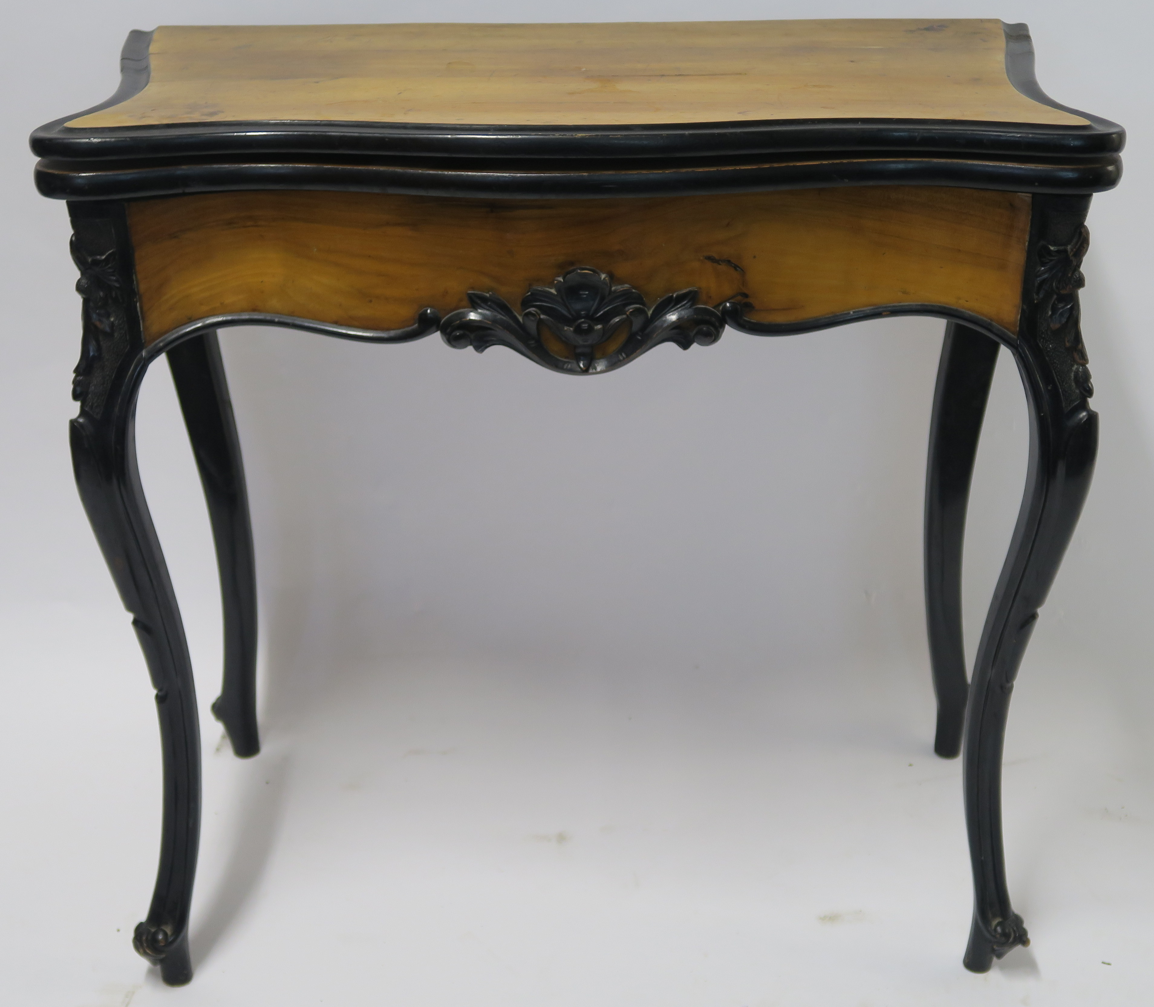 A CONTINENTAL WALNUT AND EBONISED FOLD OVER CARD TABLE, 78cm high, 82cm wide and 40cm deep Condition