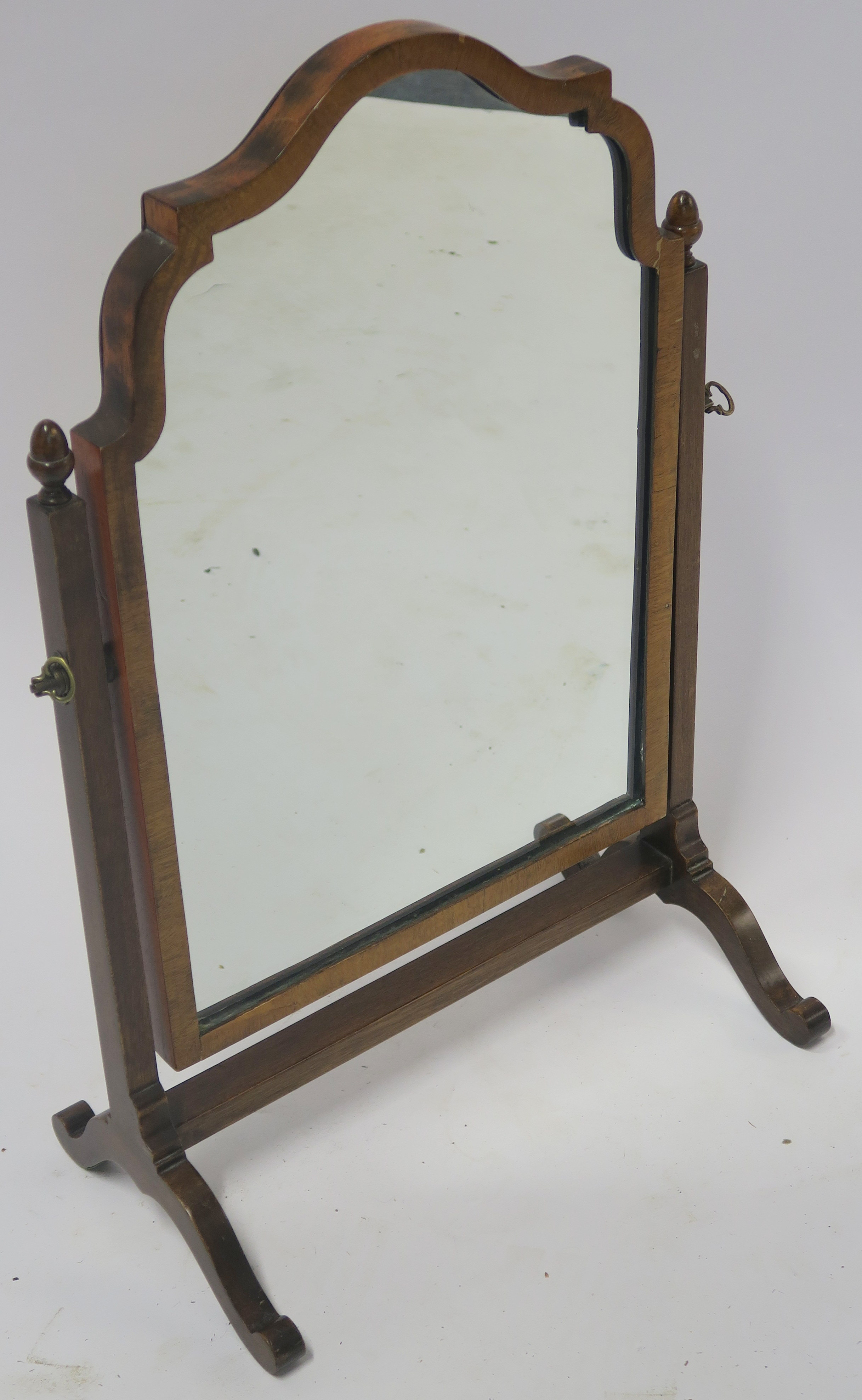 A WALNUT TOILET MIRROR 59cm high Condition Report: Available upon request