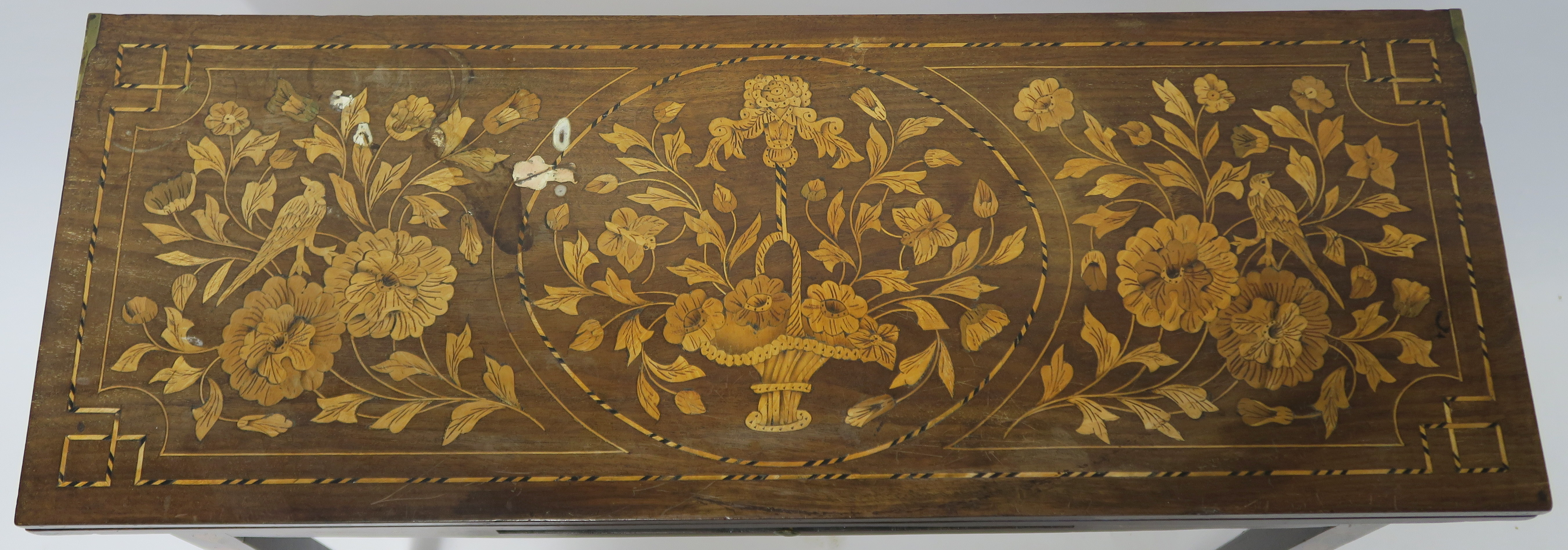 A DUTCH MARQUETRY WALNUT GAMES TABLE decorated with a basket of flowers, birds and scrolling - Image 2 of 11