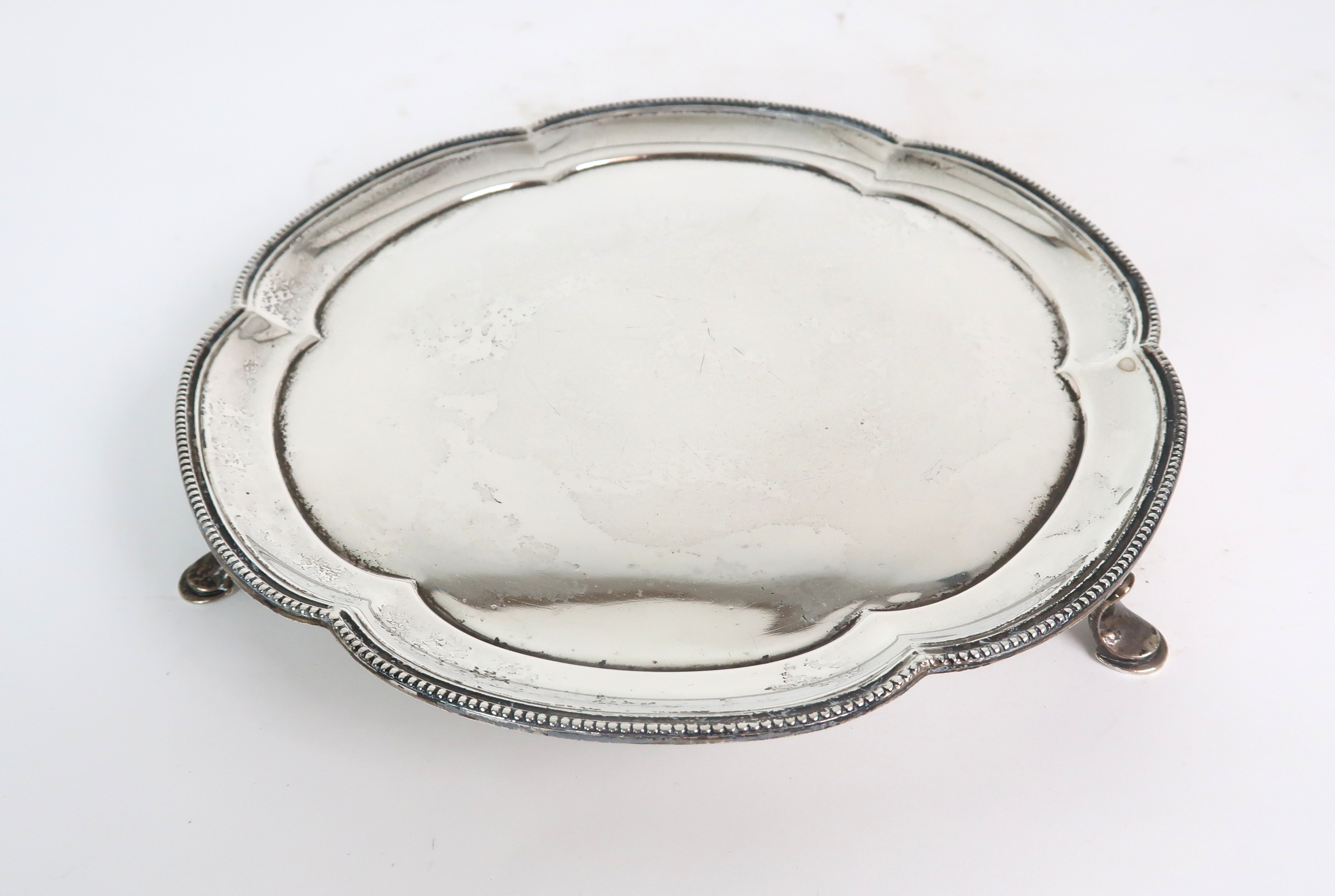 A SILVER CARD TRAY BY STOWER & WRAGG LTD Sheffield, 1935 of scalloped circular form with beaded