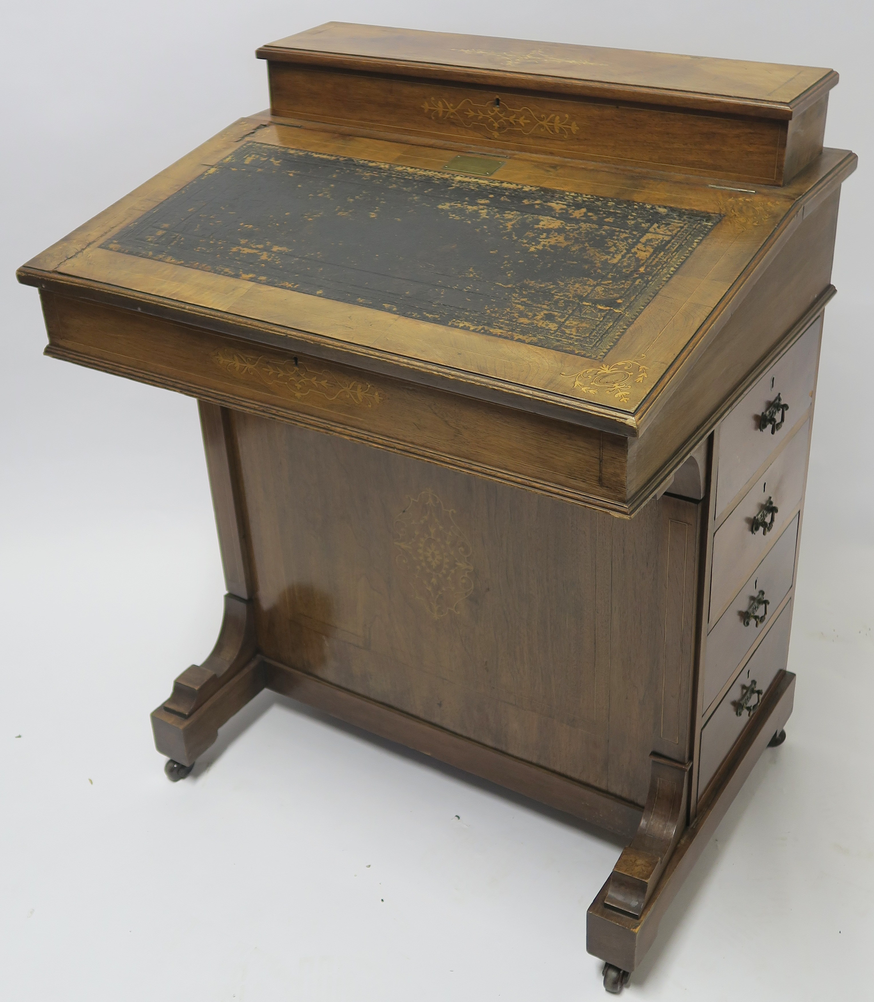 A VICTORIAN INLAID WALNUT DAVENPORT of standard design with four drawers 95cm high, 75cm wide and
