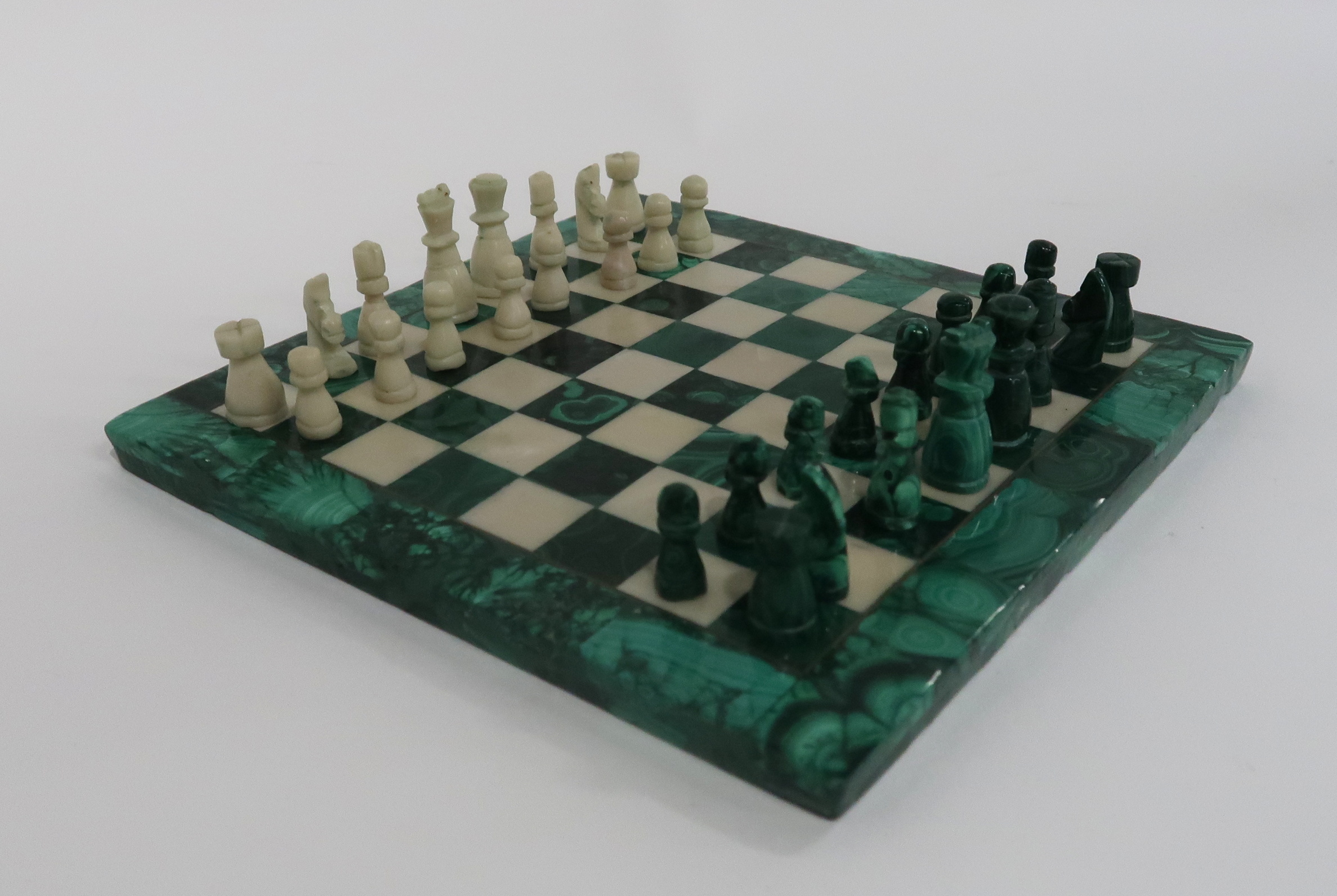 A MINIATURE MALACHITE CHESS SET AND BOARD 19cm square Condition Report: Available upon request - Image 2 of 3