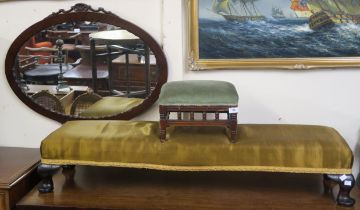 An upholstered fender footstool, 128cm long, a small stool and a wall mirror (3) Condition Report: