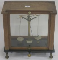 A cased set of scales by Thomson, Skinner and Hamilton, Glasgow, 43cm high x 43cm wide x 26cm deep