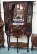 A mahogany display cabinet with open shelf with mirror back flanked by two glazed doors, drop