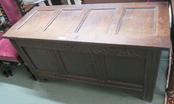 An 18th Century oak panelled coffer with carved frieze, 72cm high x 139cm wide x 56cm deep Condition