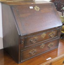 An oak desk top bureau with fitted interior and two drawers, 57cm high x 62cm wide x 39cm deep