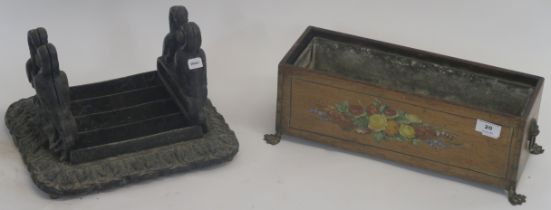 A cast iron boot scraper and a small painted planter with brass feet (2) Condition Report: Available
