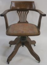 An early 20th Century oak swivel office chair Condition Report: Available upon request