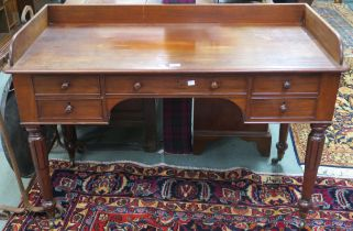 A Victorian mahogany desk with five drawers with turned handles , 85cm high x 122cm wide x 56cm deep