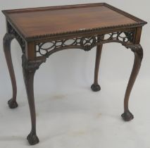 A reproduction mahogany silver table with carved frieze on carved cabriole legs with ball and claw