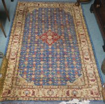 A blue ground eastern rug with central medallion and allover floral design, 187cm x 125cm