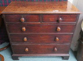 A Georgian mahogany two over three chest with turned handles on bracket feet, 86cm high x 94cm
