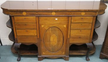 A Victorian inlaid mahogany sideboard with central door flanked by two pairs of four drawers and