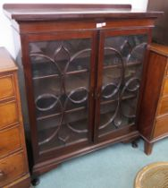 A mahogany bookcase with two glazed doors, 129cm high x 105cm wide x 37cm deep Condition Report: