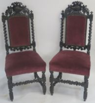 A pair of Victorian oak carved hall chairs, with a carved boars head to the back, barley twist