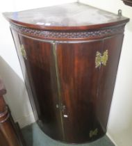 A Georgian mahogany corner cabinet with brass hinges, 108cm high x 71cm wide x 44cm deep Condition