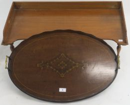An oval inlaid mahogany tray with brass handles, 66cm wide x 44cm deep and a mahogany bed tray