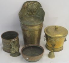 A brass coal bucket, two brass planters, door stop, bell and a brass grape carrier (6) Condition