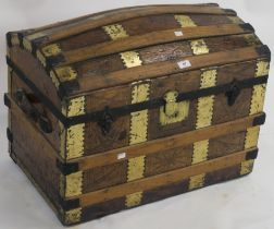 A wood bound Saratoga trunk, 55cm high x 72cm wide x 44cm deep Condition Report: Available upon